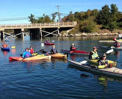 Canoe and Kayak racers getting in place for start